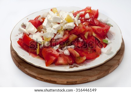 Serbian balkan salad with tomato onion and cheese.