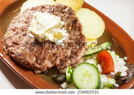 Serbian burger served on old vintage plate.  - stock photo