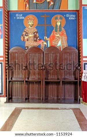 Serbian Orthodox monastery chairs - stock photo