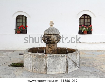 Serbian Orthodox monastery Decani - fountain. Kosovo, World Heritage Site by UNESCO - stock photo