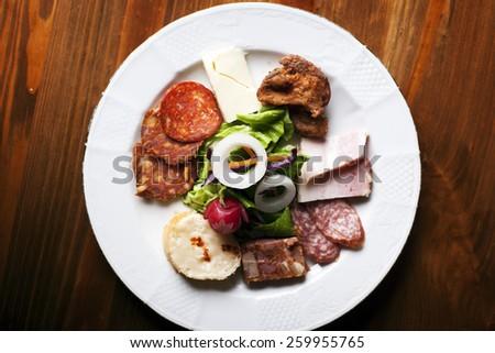 Serbian salumi meat platter - prosciutto ham, bresaola, pancetta, salami and parmesan - stock photo