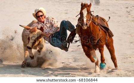 SERDANG, MALAYSIA - AUG 14 : A cowboy in action during Malaysian Agriculture, Horticulture and Agrotourism Exhibition 2008 on August 14, 2008 in Serdang outside Kuala Lumpur, Malaysia - stock photo
