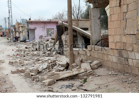 SEREKANIYE, SYRIA-MARCH 22: View of war damage from Serekaniye. Syrian war plane bombed Serekaniye. The Photo Taken, March 22, 2013.
