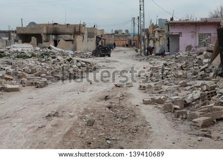 SEREKANIYE, SYRIA-MARCH 22: View of war damage from Serekaniye. Syrian war plane bombed Serekaniye. The Photo Taken, March 22, 2013. - stock photo