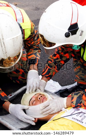 SEREMBAN, MALAYSIA - APRIL 8: Firefighter (EMRS) Emergency Medical Rescue Services Team in action during DMEX exercise at Negeri Sembilan on April 8, 2012 Seremban, Malaysia  - stock photo