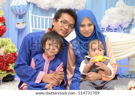 SEREMBAN,MALAYSIA - JULY 14, 2016: Happy family!!  Malay Naming Ceremony event at Seremban. In malay culture, naming ceremony of baby is to introduce the baby to neighbor.baby hair will be shave