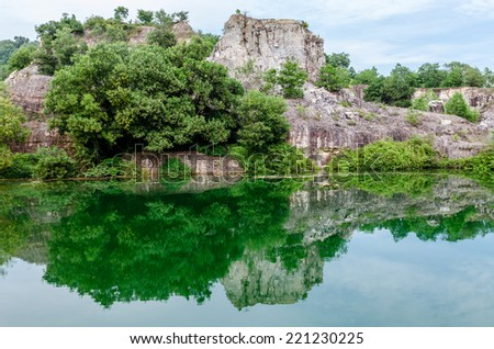 Serene and quiet Blue Lake on Ta Pa moutain  in Chau Doc city, An Giang, Vietnam. Chaudoc city near Cambodia is famous tourist spots of the Mekong river tours. - stock photo
