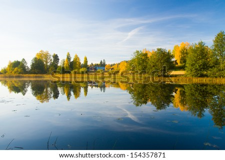Serene autumn waterscape beautiful colors - stock photo