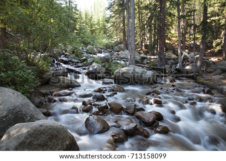 Serene Cascading Mountain Stream with Smooth Milky Water