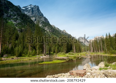 Serene lake along Cascade Canyon in the Teton Mountains