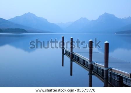 Serene Lake Scene with Floating Dock (Lake McDonald, Glacier National Park) - stock photo