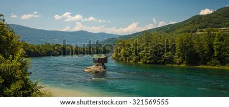 Serene lonely house on the river Drina in Bajina Basta, Serbia - stock photo