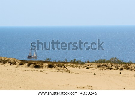 serene summer water and sand landscape with the yacht - stock photo