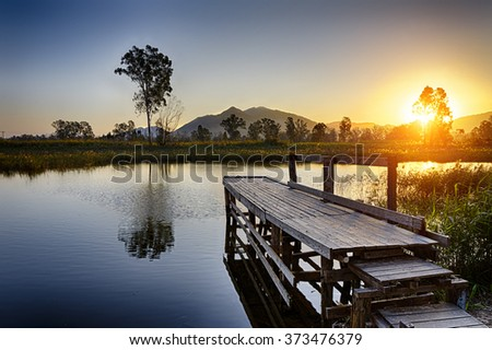 Serene Sunrise over fishing Jetty , hong kong Nam Sang Wai - stock photo