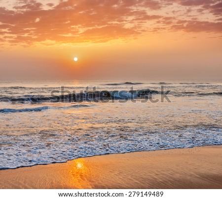 Serene tranquil morning seascape on sunrise on beach - stock photo