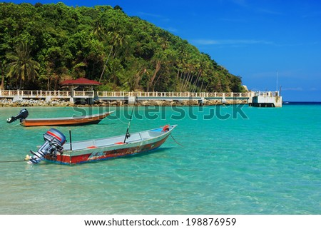 Serene view of the speedboats on the beach, Perhentian Island,  - stock photo