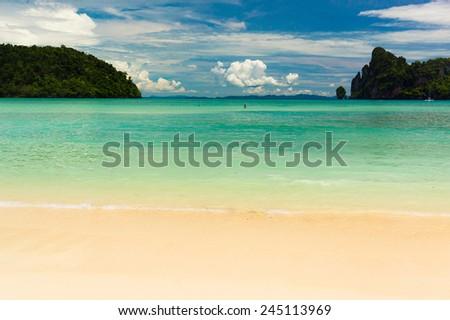 Serene Waters Sunny Beach  - stock photo