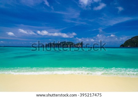 Serene Waters Sunny Beach  - stock photo