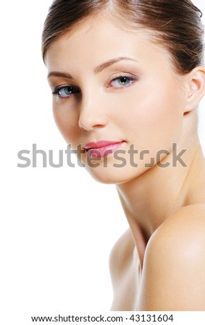 Serene woman face with a wellness complexion of her skin - isolated on white - stock photo