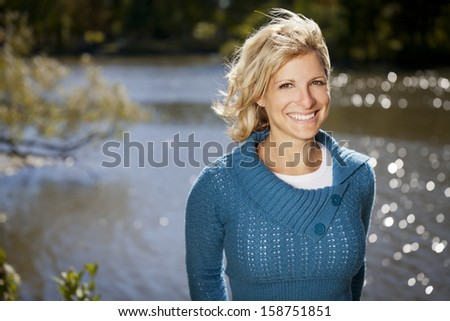 Serene Woman Relaxing At The Lake - stock photo