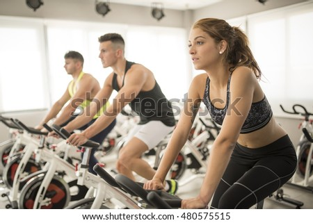 Serene woman training in spinning bikes
