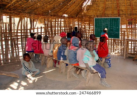 SERENGETI ,TANZANIA - JUNE 20 ; Maasai children at there classroom on june 20,2013 .Tanzania.Only 48 percent of Maasai children  go to school, only 10 percent of them make it to secondary school.  - stock photo