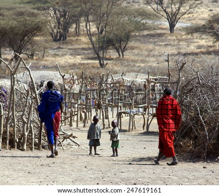 SERENGETI ,TANZANIA - JUNE 20 ; Maasai people in there village on june 20,2013 .Tanzania.The Maasai are a ethnic group of nomadic people inhabiting southern Kenya and northern Tanzania.   - stock photo
