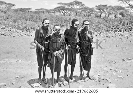SERENGETI- TANZANIA - OCTOBER 20: Unidentified Young Masai men (Moran) wear black and markings for several months following their circumcision on October 20, 2011 Serengeti Tanzania.