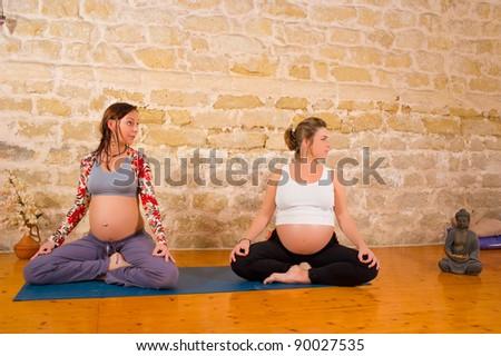 Serenity and joy at prenatal yoga exercises - stock photo