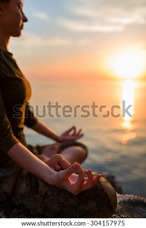 serenity and yoga practicing at sunset, meditation.Twilight in Goa state,India - stock photo