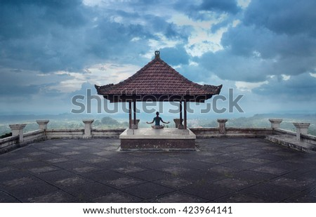 serenity and yoga practicing at twilight, meditation on Bali,Indonesia - stock photo