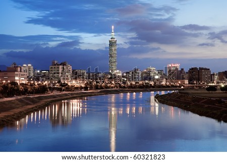 Serenity cityscape with skyscraper and river in night in Taipei, Taiwan. - stock photo