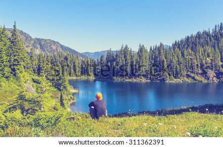 Serenity lake in the mountains.Instagram filter. - stock photo