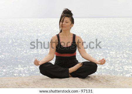 Serenity - Meditation by the ocean  - stock photo