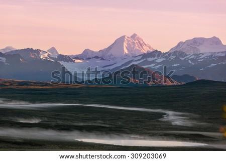 Serenity sunrise scene on Denali highway - stock photo