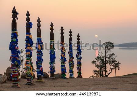 Serge Poles at Cape Burhan at sunrise. Olkhon island, Lake Baikal, Irkutsk region, Russia. - stock photo