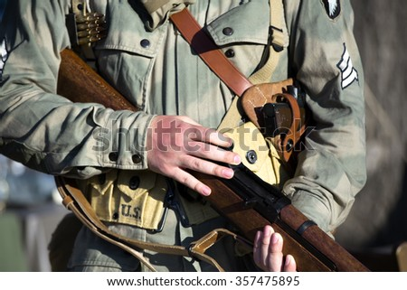 Sergeant 101st airborne division US army with weapon in wwii / military 101st airborne division with rifle in ww2 - stock photo