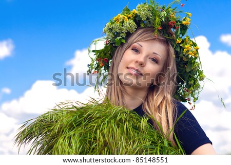 series a portrait of the beautiful girl in a wreath which reaps a crop in the field - stock photo