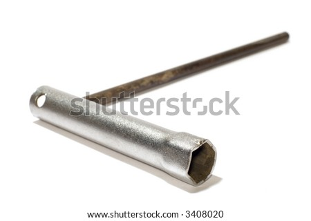 series object on white tool spark-plug wrench - stock photo