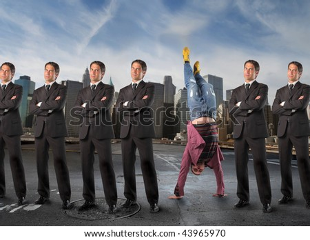 series of a business men and a boy in headstand - stock photo