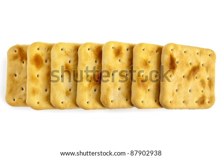 Series of a few square crackers isolated on white background - stock photo