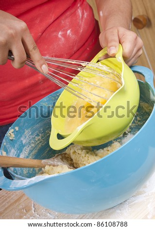 Series of a woman cooking in the kitchen with bright bowls - stock photo