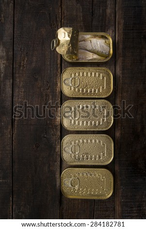Series of boxes for storage containing sardines in olive oil - stock photo