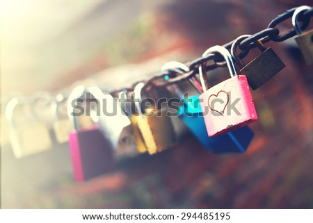 Series of colored padlocks with hart shape - stock photo