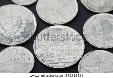 Series of Cuban coins on black background