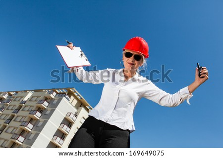 Series of images and video featuring a home, real estate agent, and home owners. Agent was very happy and is celebrating with Arms Outstretched a good deal for home sales. - stock photo