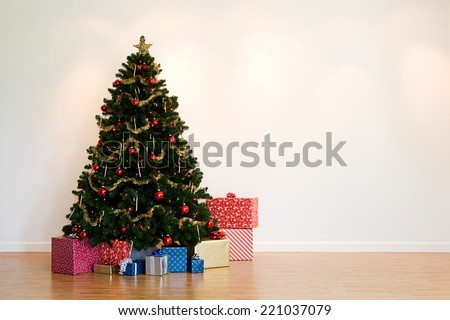 Series of images setting up a Christmas tree from putting up the base, to having gifts underneath. 19 altogether. - stock photo