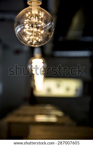 series of modern design light bulbs aligned in a row