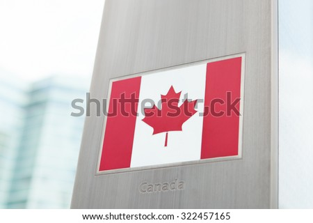 Series of national flags on pole - Canada - stock photo