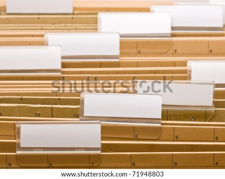 Series of office folders with blank labels - stock photo